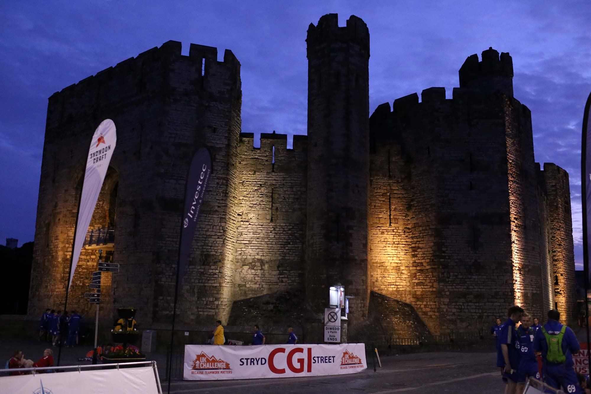 castle at night surrounded by race participants